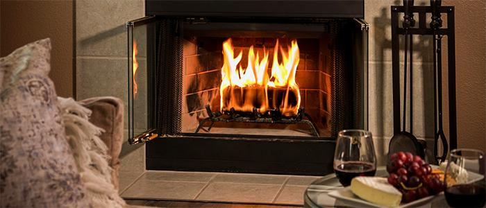 duraflame Gold 4.5lb firelog burning with wine and cheese plate