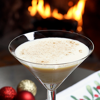 White Christmas Martini in martini glass with duraflame fire burning in background